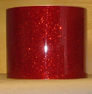 Drum Wrap Material: Example of Red Glass Glitter on a drum shell also known as crushed glass.
