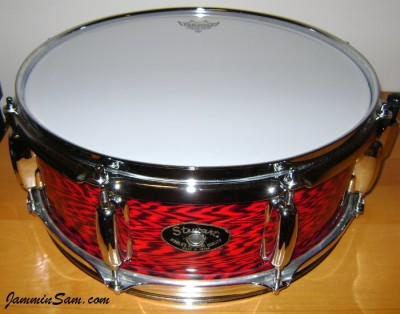 Photo of Craig Law's snare drum top with Vintage Red Onyx Pearl drum wrap (11)