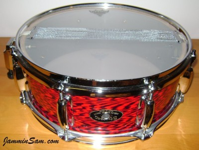 Photo of Craig Law's snare drum bottom with Vintage Red Onyx Pearl drum wrap (12)