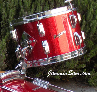 Photo of Roberto Barahona's Rogers drums with Red Vintage Sparkle drum wrap (4)
