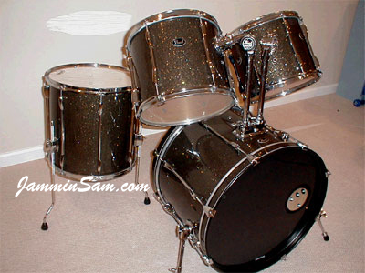 Photo of Sven Bridstrup's Pearl drums with Rootbeer Glass Glitter drum wrap