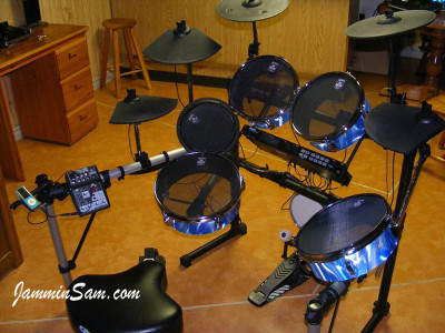 Photo of Jamie Heim's electric drums with Satin 60's Blue drum wrap (40)