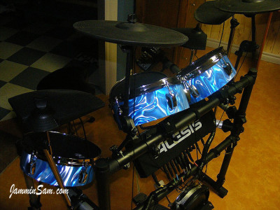 Photo of Jamie Heim's electric drums with Satin 60's Blue drum wrap (42)
