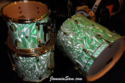 Photo of Eric Seelig's drums with Fire Green Satin drum wrap (1)
