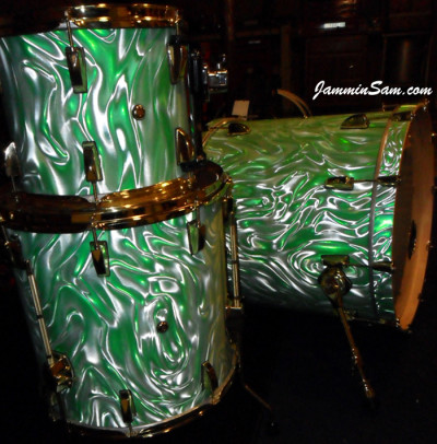 Photo of Eric Seelig's drums with Fire Green Satin drum wrap (2)