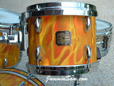 Photo of Mark Watts' drums with Fire Orange Satin drum wrap (1)