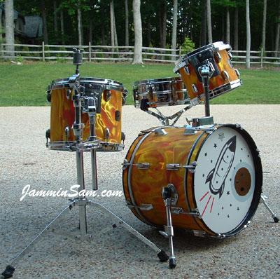 Photo of Mark Watts' hybrid drumset with Fire Orange Satin drum wrap