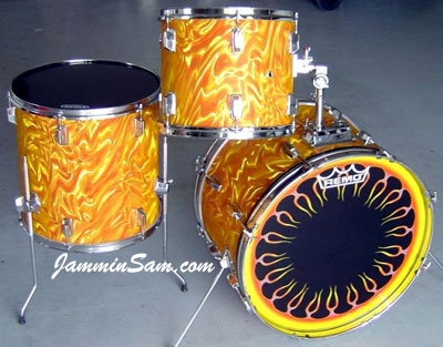 Photo of Nick Bomleny's drums with Fire Orange Satin drum wrap