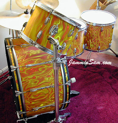 Photo of Pete Neises'Ludwig set with Fire Orange Satin drum wrap. Also known as Marmalade Swirl