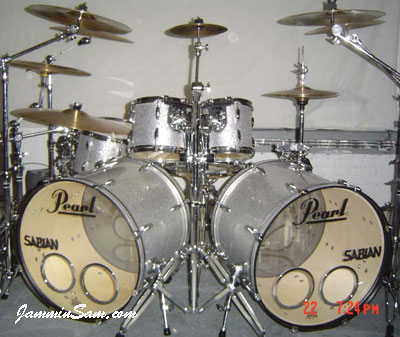 Photo of Dylan Archilla's Pearl drum set with Silver Vintage Sparkle drum wrap