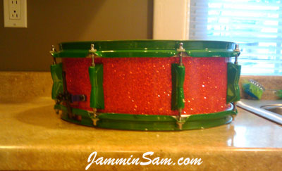 Photo of Aamir Bailey's snare with Super Tangerine Glass Glitter drum wrap