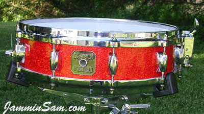 Photo of Kevin Oppendike's Gretsch snare with Super Tangerine Glass Glitter drum wrap