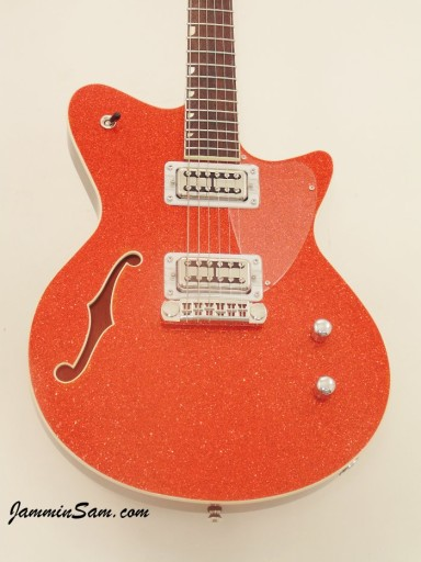 Photo of John Estes custom Koll Duo Glide guitar with our Super Tangerine Glass Glitter wrap