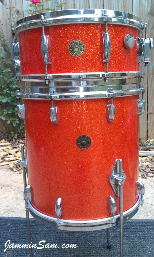 Photo of Mark Crowson's tom drum with Super Tangerine Glass Glitter drum wrap on top of original to compare with (5)