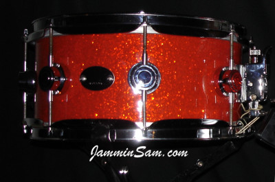 Photo of Keith Mikami's DW snares with Tangerine Glass Glitter drum wrap (2)