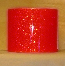 Drum Wrap Material: Example of Super Tangerine Glass Glitter on a drum shell also known as crushed glass.