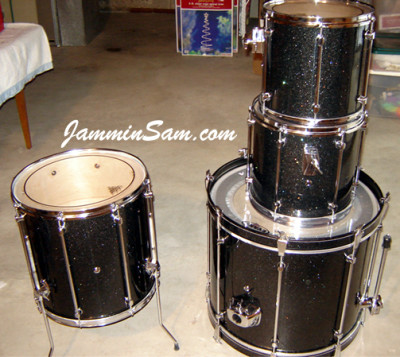 Photo of Morgan King's Mapex drums with True Black Glass Glitter drum wrap (1)