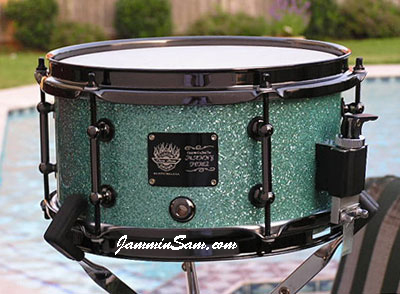 Photo of Brian Cocivera's snare drum with Turquoise Glass Glitter drum wrap