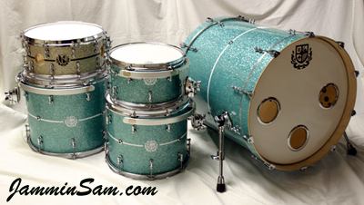 Photo of Tom Diverio's drums with Turquoise Glass Glitter drum wrap (1)