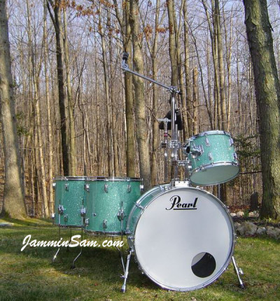 Photo of Vincent Galeano's Pearl drums with Turquoise Glass Glitter drum wrap (1)