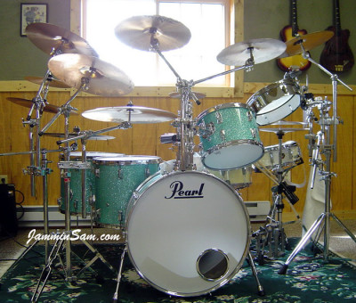 Photo of Vincent Galeano's Pearl drums with Turquoise Glass Glitter drum wrap (7)