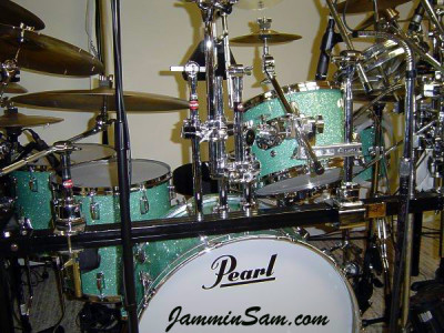 Photo of Vincent Galeano's Pearl drums with Turquoise Glass Glitter drum wrap (8)