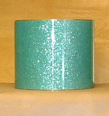 Drum Wrap Material: Example of Turquoise Glass Glitter on a drum shell also known as crushed glass.
