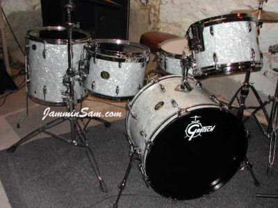 Photo of Charles Benedicto's Gretsch drums with Vintage White Pearl drum wrap (5)