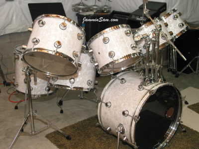 Photo of Doug Digennaro's Rogers drum set with Vintage White Pearl drum wrap on (9)