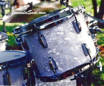 Photo of Mike Pickel's drums with Vintage White Pearl drum wrap (2)