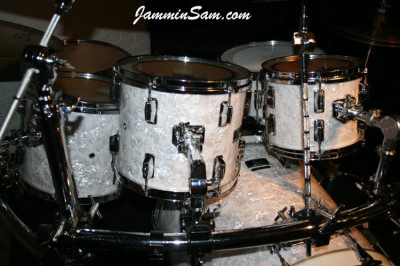 Photo of Jerry Pate's Pearl drumset with Vintage White Pearl drum wrap (2)