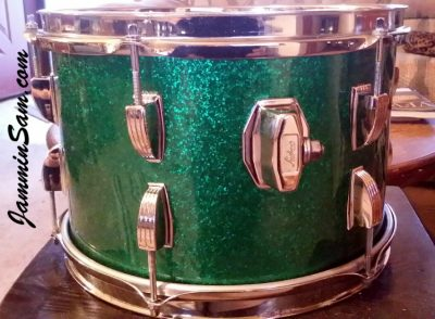 Photo of Jon Glenn's Ludwig tom-tom with JS Sparkle Green drum wrap (31)