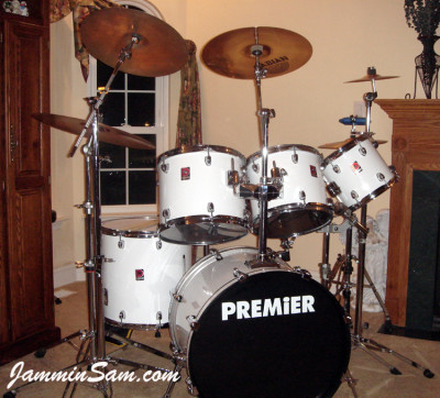Photo of Michael Coogan's Premier drum set with JS Hi Gloss White drum wrap