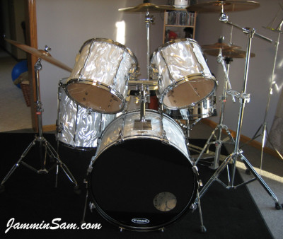 Photo of Glenn Giesregen's Tama Rockstar drums with White Satin Flame drum wrap (1)