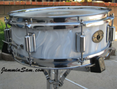 Photo of Jim Sprague's Rogers snare with White Satin Flame drum wrap (2)