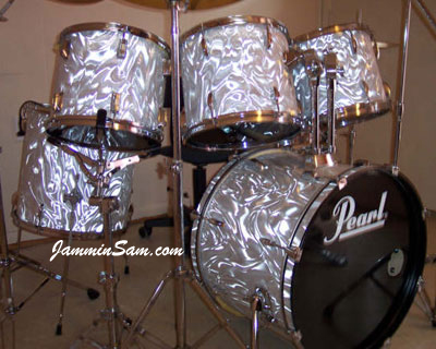 Photo of Kevin Davis' Pearl drumset with White Satin Flame drum wrap