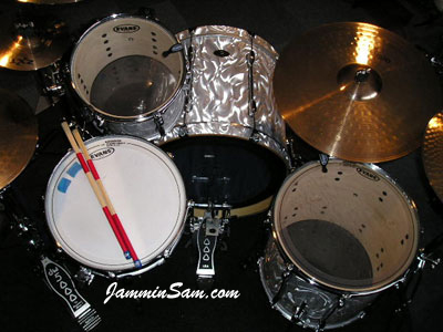 Photo of Paul Senia's drums with White Satin Flame drum wrap