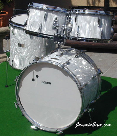 Photo of Peter Sagerer's Sonor drum set with White Satin Flame wrap material (1)