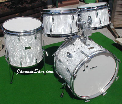 Photo of Peter Sagerer's Sonor drum set with White Satin Flame wrap material (2)