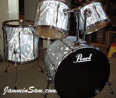 Photo of Rick Daub's Pearl kit with White Satin Flame drum wrap (10)