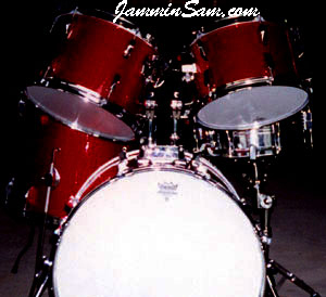 Photo of Craig Law's set of drums with JS Hi Gloss Wine Red drum wrap