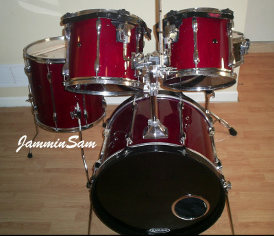 Photo of Jesse Hightower's Tama drums with JS Hi Gloss Wine Red drum wrap (3)
