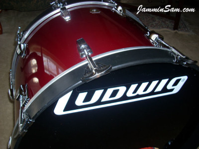 Photo of Jim Sabel's Ludwig bass drum with JS Hi Gloss Wine Red drum wrap (2)