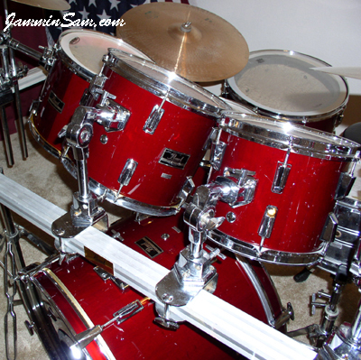 Photo of Joe Ekl's Pearl drums with JS Hi Gloss Wine Red drum wrap (4)