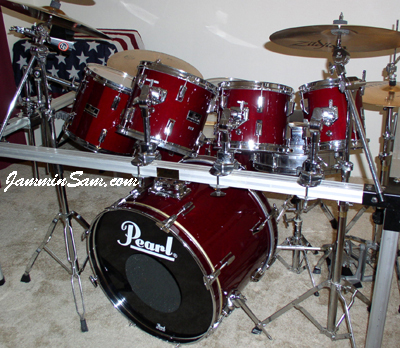 Photo of Joe Ekl's Pearl drumset with JS Hi Gloss Wine Red drum wrap
