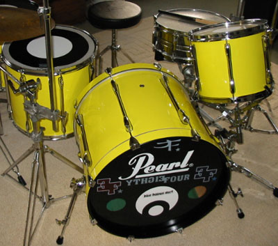 Photo of Brian Mikami's drumset with Hi Gloss Crazy Yellow drum wrap